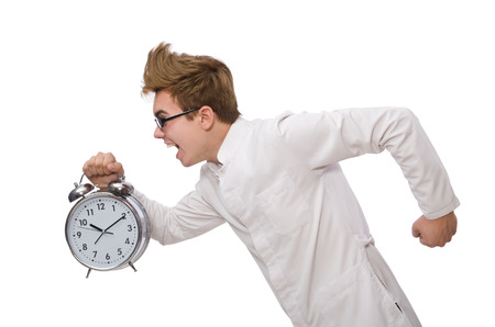 hurrying: Funny doctor with alarm clock isolated on white