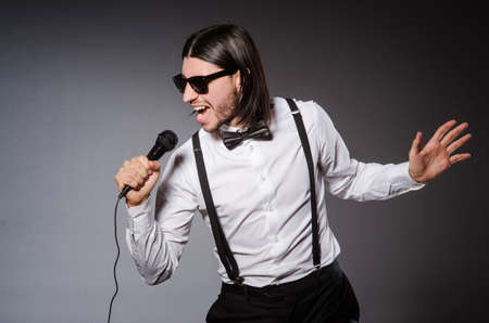 discoteque: Funny singer with microphone at the concert