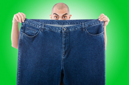 oversized: Man in dieting concept with oversized jeans