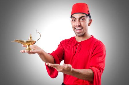 turkish man: Turkish man with lamp on white Stock Photo