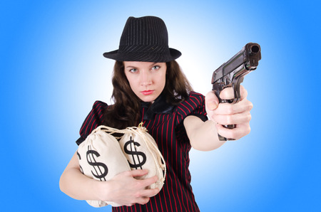 female assassin: Woman gangster with gun and money Stock Photo