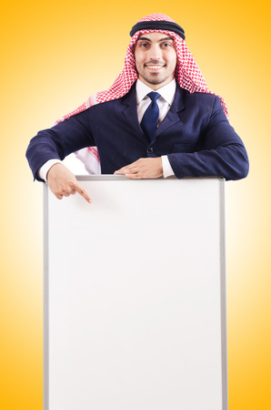 thoub: Arab man with blank board for message Stock Photo