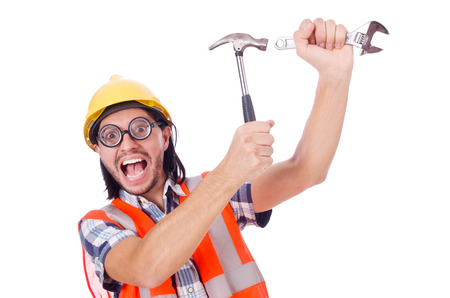 safety googles: Funny young construction worker with hammer and wrench isolated on white