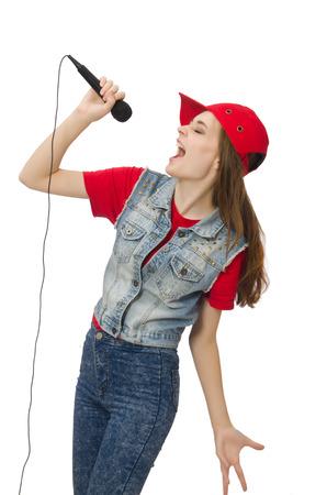 cantando: Muchacha bonita que canta karaoke aislado en blanco Foto de archivo