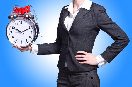Woman with dynamite and clock on white photo