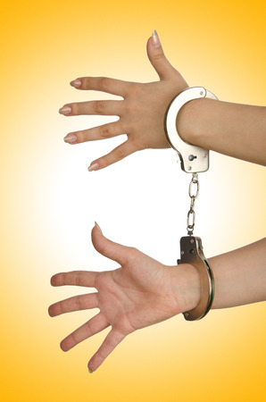 handcuffed hands: Handcuffed hands on white background Stock Photo