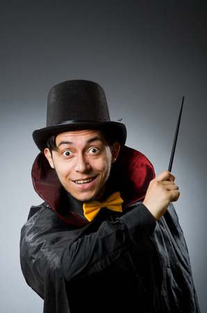 conjuror: Funny magician man with wand and hat