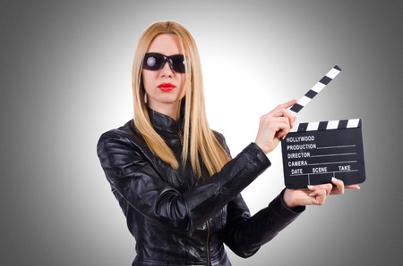 movie clapper: Woman with movie clapper on white
