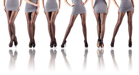 white stockings: Woman legs isolated on the white  Stock Photo