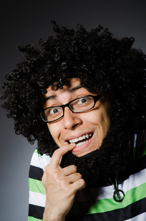 afro hairdo: Funny man with afro hairstyle isolated on white Stock Photo