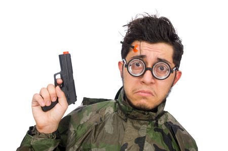 dissapointed: Military man with a gun isolated on white