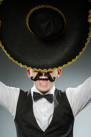 mexican black: Smiling mexican with sombrero isolated on white