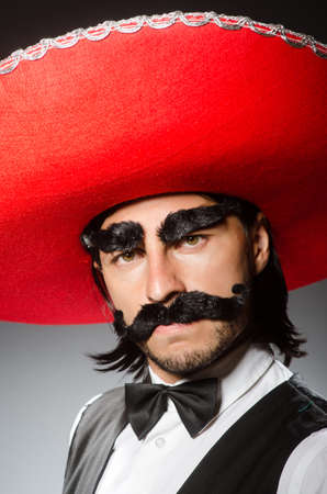 serenade: Mexican man wears sombrero isolated on white Stock Photo