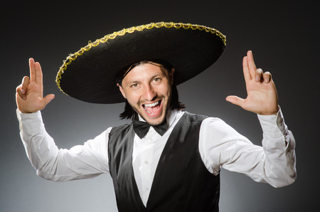 wears: Mexican man wears sombrero isolated on white Stock Photo