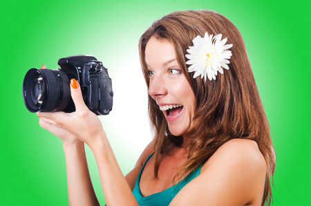 newsman: Attractive female photographer on white