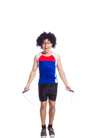 Guy jumps with skipping rope isolated on white photo