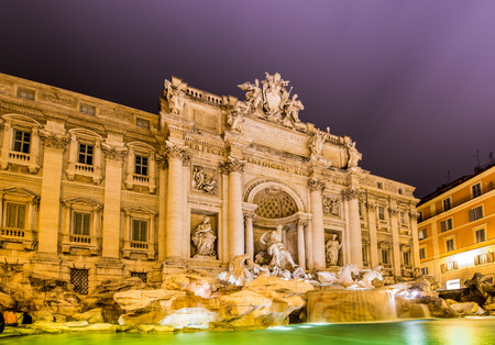Fountain Trevi during evening hours in Rome photo