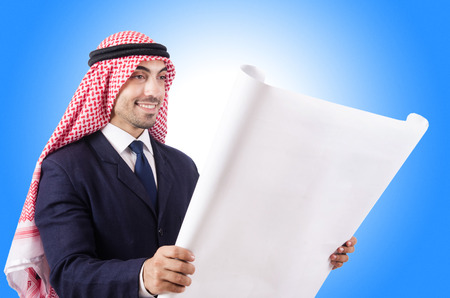Arab engineer with drawings on white photo
