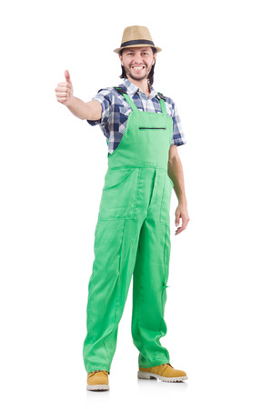 solicitous: Young cheerful gardener in hat and green uniform isolated on white