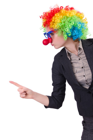 Businessman with clown wig isolated on white photo
