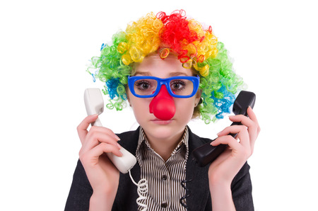 dissapointed: Businessman with clown wig isolated on white Stock Photo