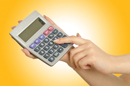 subtraction: Hand holding calculator on white