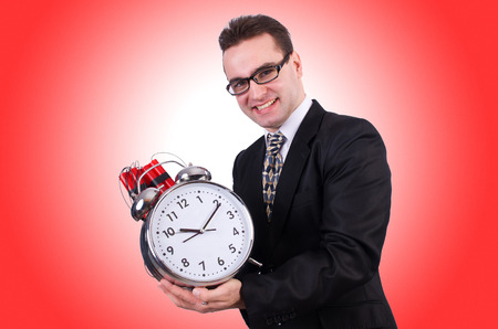 Man with time bomb isolated on white photo