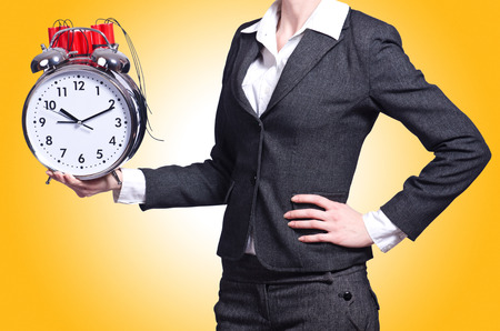 dynamite: Woman with dynamite and clock on white Stock Photo