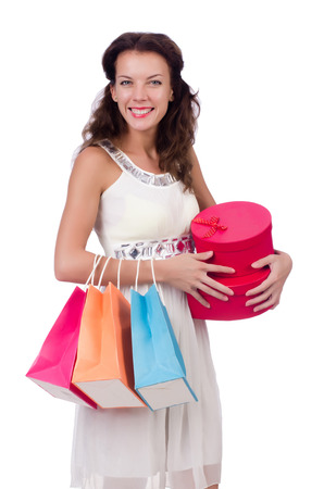 A girl does shopping isolated on white photo