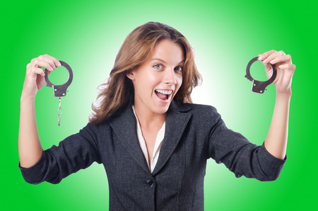 control fraud: Female businesswoman with handcuffs on white