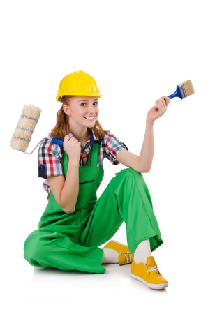 foreman: Female foreman with paint brush isolated on white Stock Photo