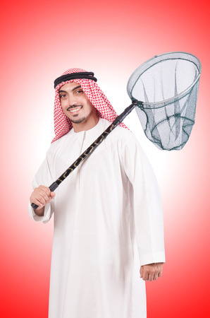 catching: Arab businessman with catching net on white Stock Photo