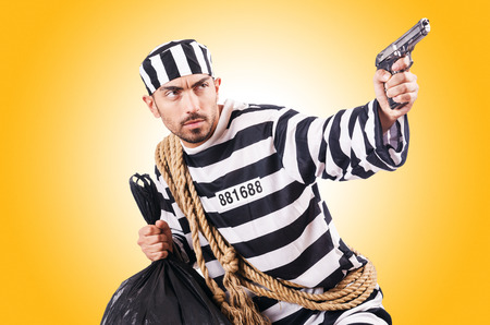 criminal: Convict criminal in striped uniform Stock Photo