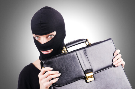 espionage: Industrial espionage concept with person in balaclava Stock Photo