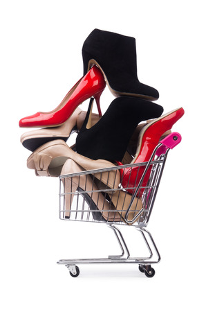 footgear: Woman shoes in shopping cart on white Stock Photo