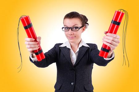 dynamite: Businesswoman with dynamite on white