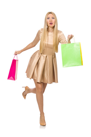 hurrying: Woman many shopping bags after shopping isolated on white