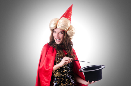 conjuror: Female magician isolated on white Stock Photo