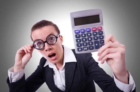 nerd girl: Nerd female accountant with calculator Stock Photo