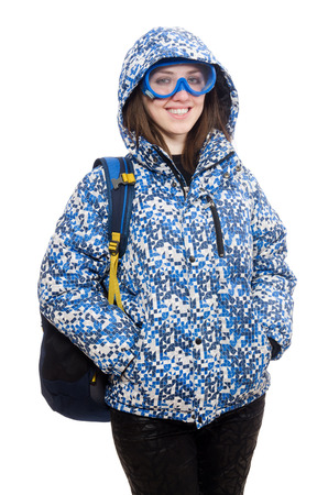 black ski pants: Young optimistic girl with rucksack isolated on white