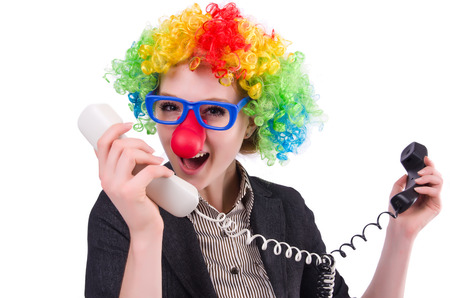 young office workers: Businessman with clown wig isolated on white Stock Photo