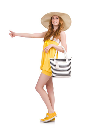 hitch hiker: Young woman in yellow summer dress isolated on white Stock Photo