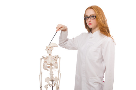 practioner: Young female doctor with skeleton isolated on white Stock Photo