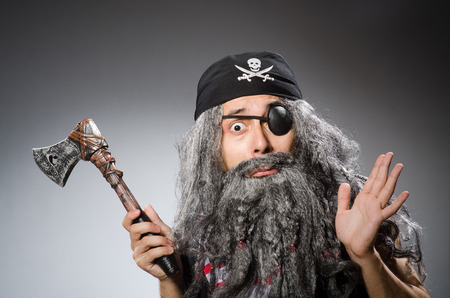 grey eyed: Man in pirate costume isolated on white