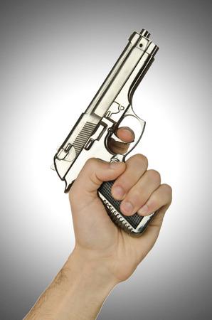 Gun in the hand on white photo