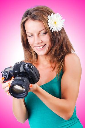 female photographer: Attractive female photographer on white