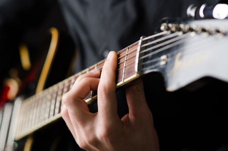 music player: Man with guitar during concert