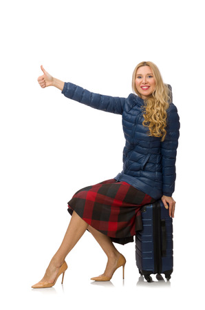 hitch hiker: Pretty female model in blue jacket isolated on white
