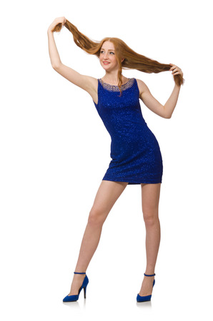 Pretty red hair girl in blue dress isolated on white photo
