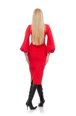 Beautiful woman in red long dress isolated on white photo